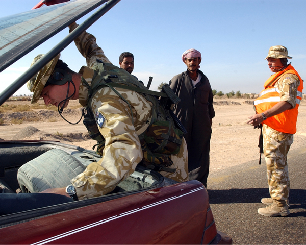 A weapons search at a vehicle checkpoint, 2003