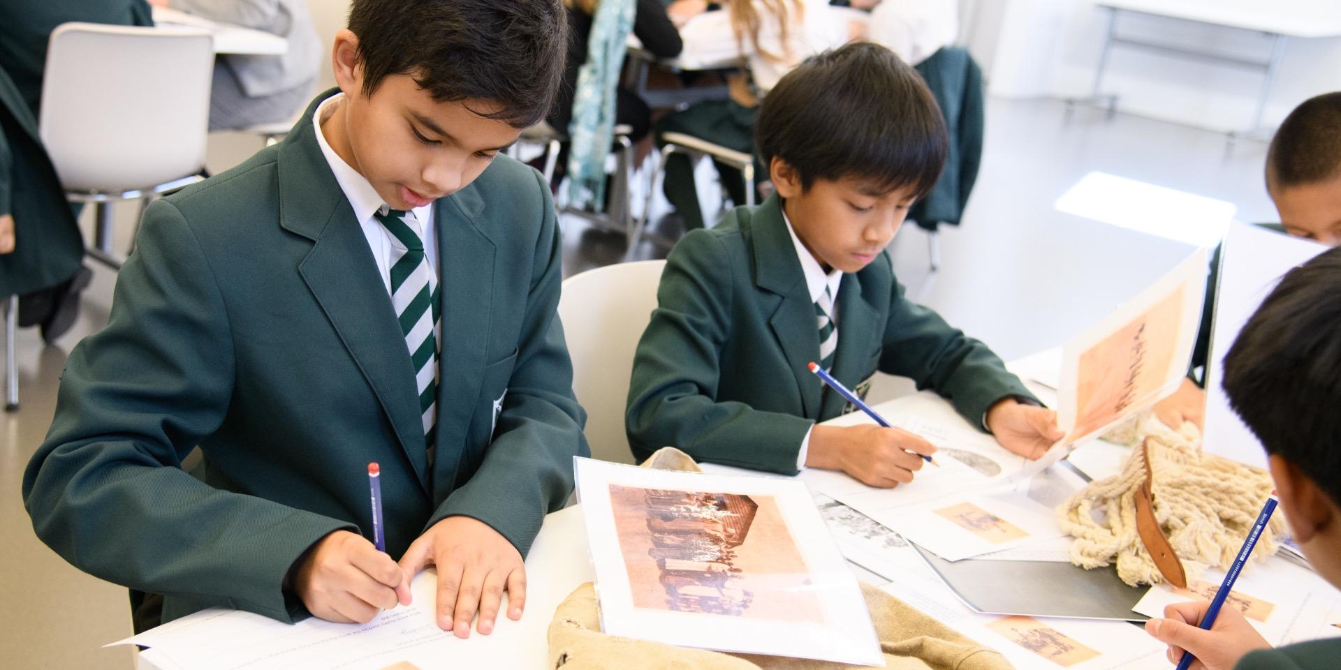 Schoolchildren working with our First World War archive