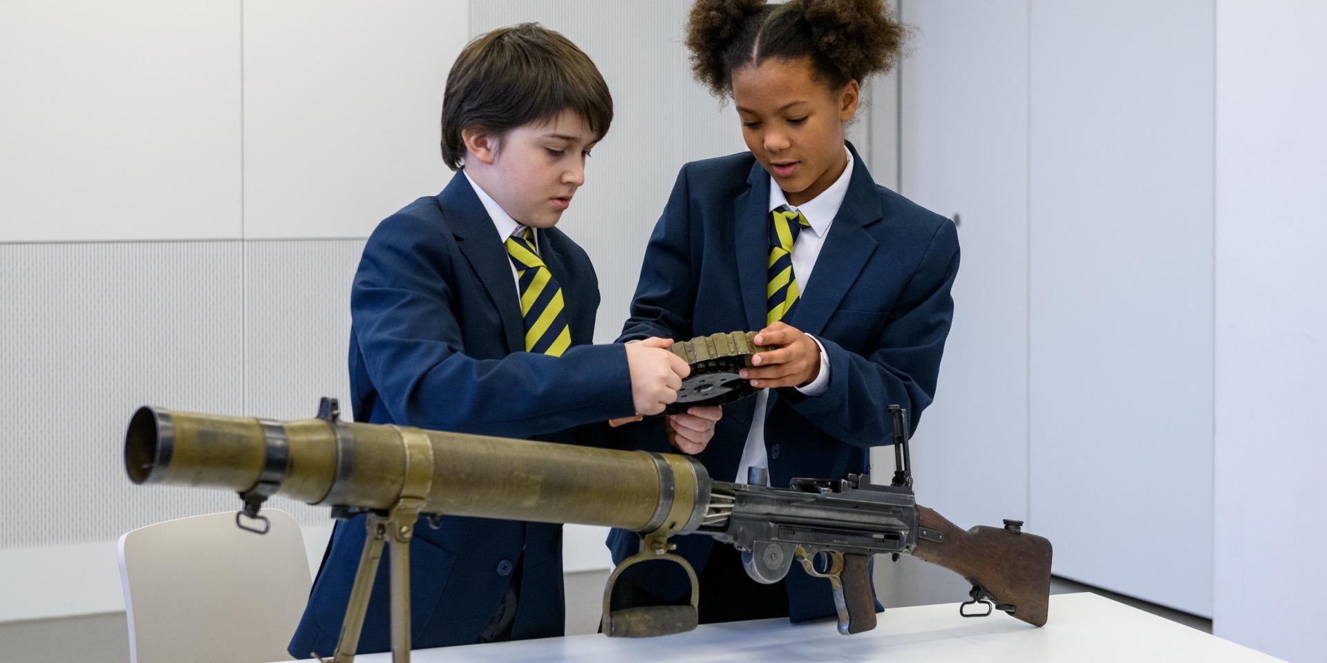 School children examining First World War weaponry