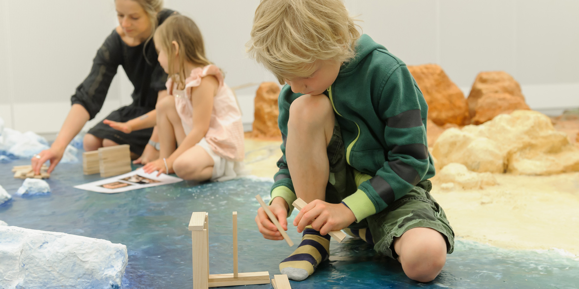Families building wooden block structures