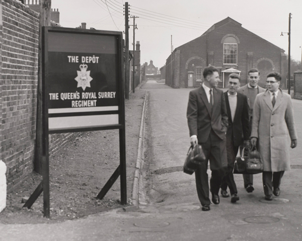 New recruits to The Queen's Royal Surrey Regiment arrive at the regimental depot, c1960