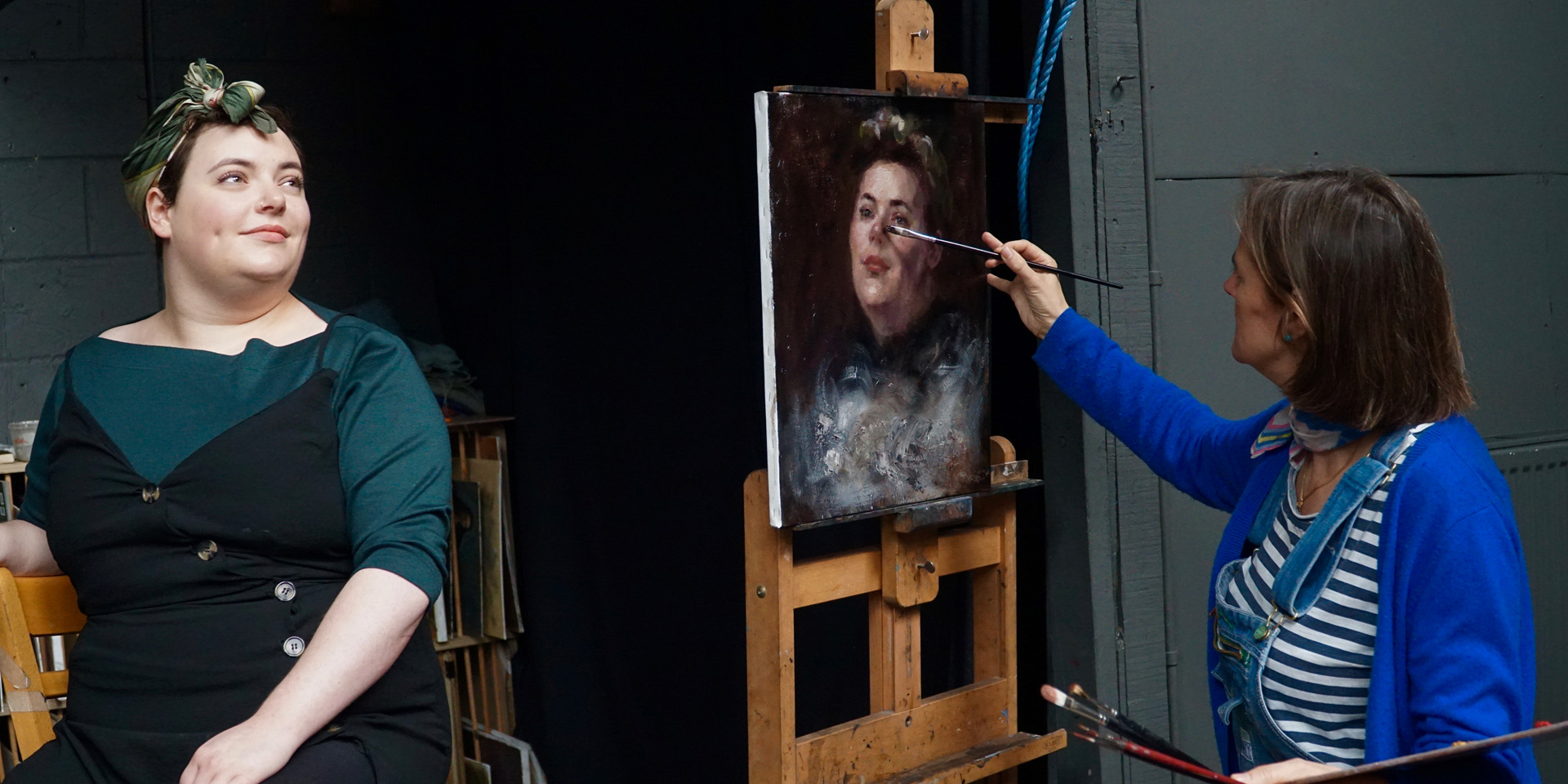 Ann Witheridge of London Fine Art Studios painting a woman's portrait