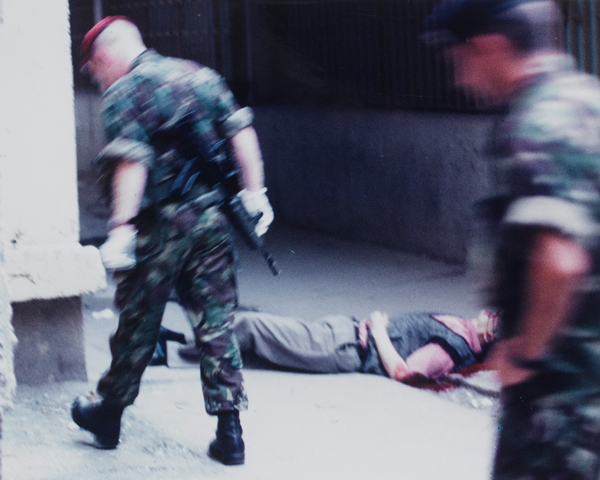 The Royal Military Police at the scene of a murder of a Serbian civilian by an Albanian Kosovan, Pristina, 1999