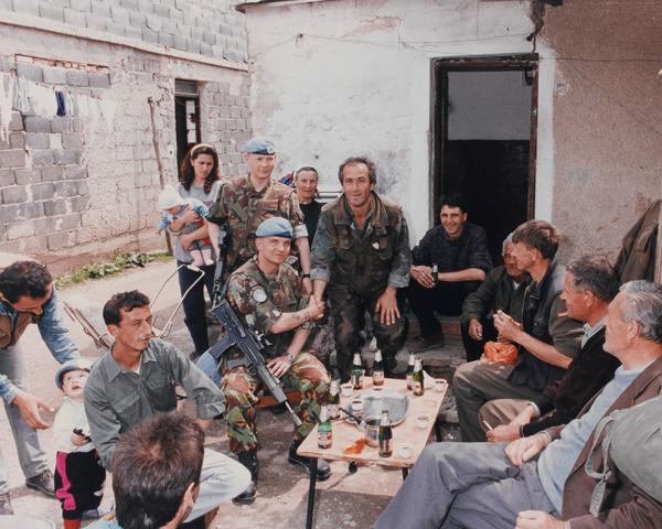 Members of The Royal Anglian Regiment meet Bosnian villagers, c1993