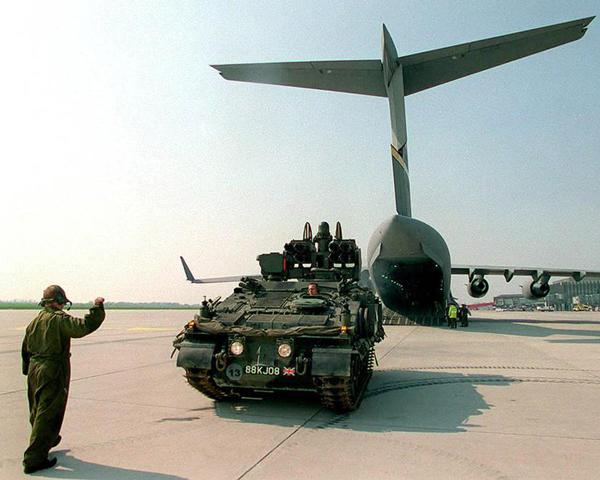 British Army vehicles disembark from transport aircraft, Macedonia, 1999