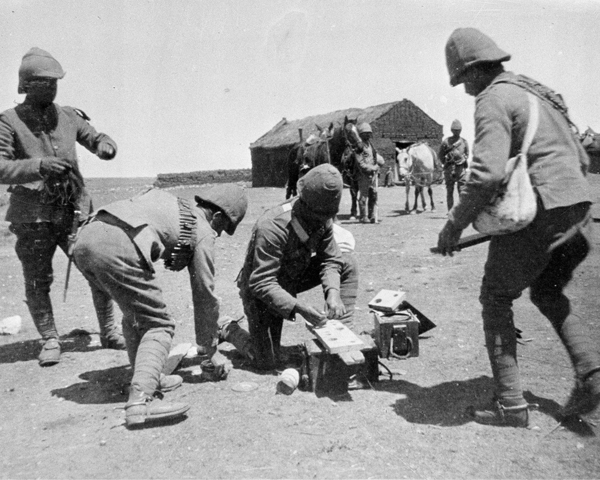 Royal Engineers preparing to blow up a Boer farm, c1901