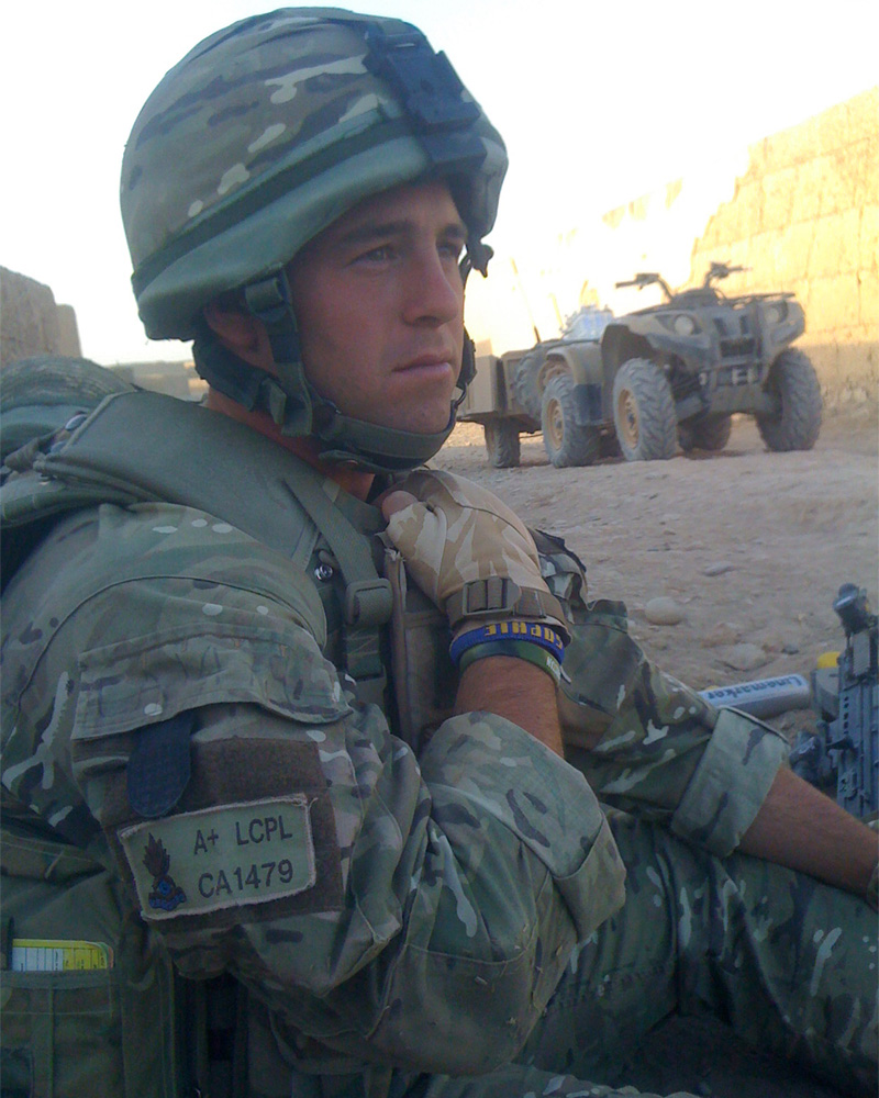Lance Corporal De Matos on tour in Afghanistan wearing his lucky wristband, c2010