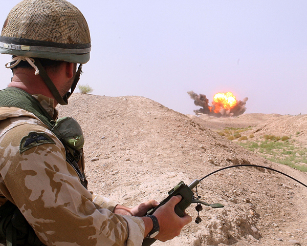 A member of 33 (Explosive Ordnance Disposal) Regiment carries out a controlled explosion, Helmand, 2006