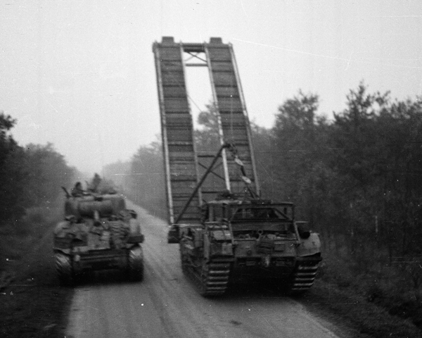 A Churchill AVRE bridge-layer passing a Sherman tank, 1944