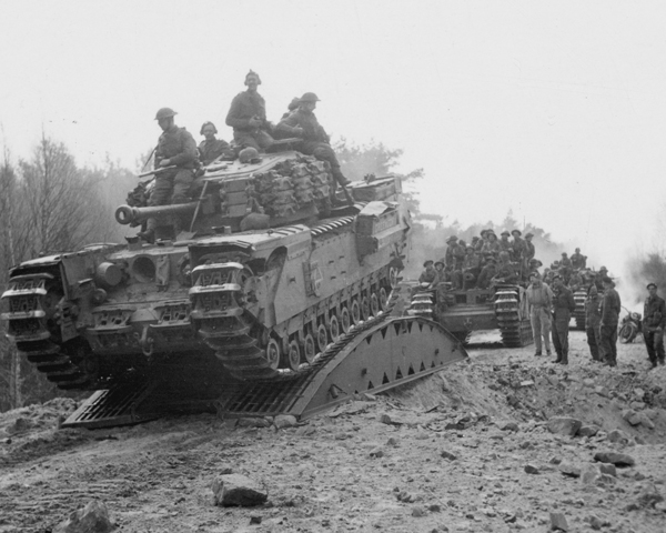 Tanks crossa bridged crater during the advance to the Elbe, April 1945