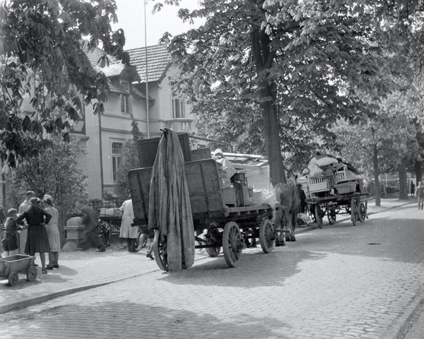 Civilians evacuate following the Army requisition of their homes, Elmshorn, 1945