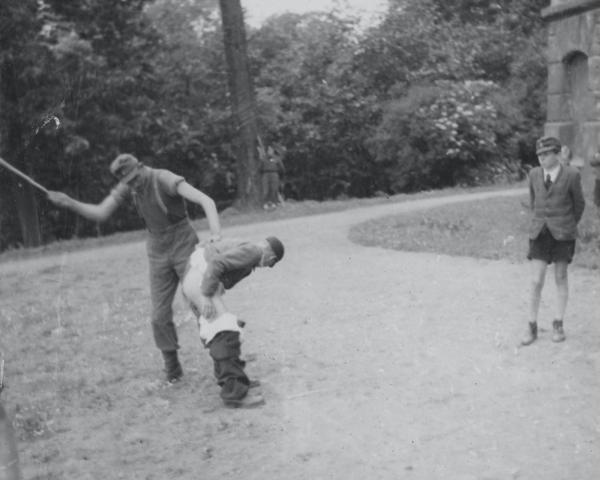 German youths being beaten for stealing from British troops, 1945