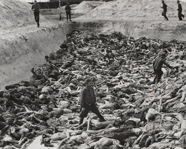 SS guards forced to bury their victims at Belsen, 24 April 1945