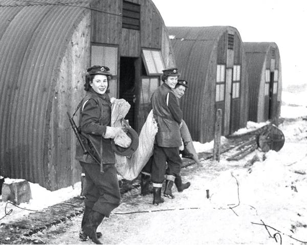 ATS women outside their Nissen huts, 1945
