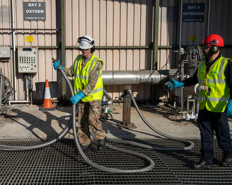 A Royal Engineer fills a tanker with oxygen for delivery to hospitals in London, March 2020