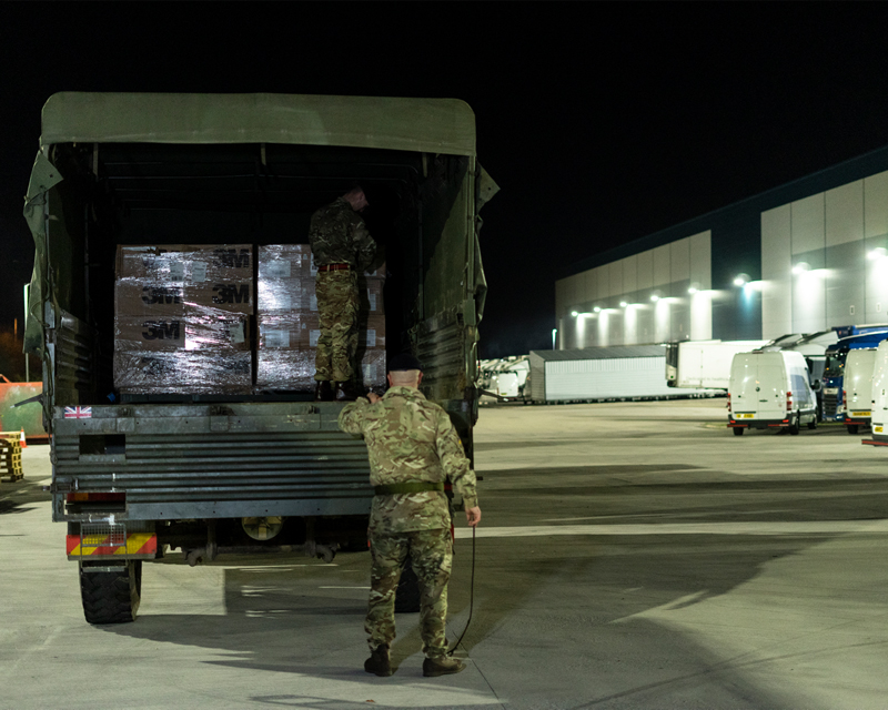 A Royal Logistics Corps lorry collects face masks for delivery to NHS locations in London, March 2020