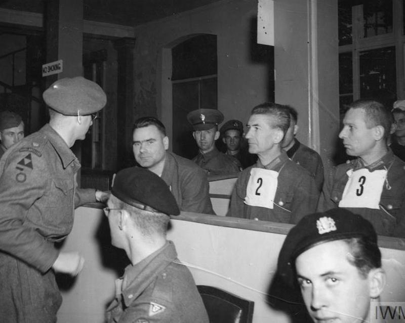 Major T. C. M. Winwood, Commandant Josef Kramer's defence council, speaking to him at the trial, 19 September 1945