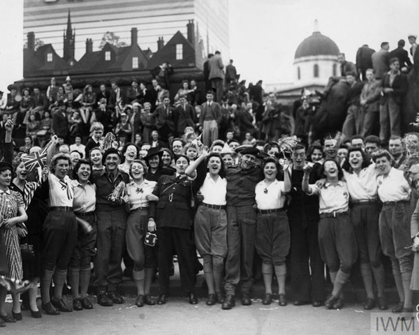 Members of the Women's Land Army celebrate with soldiers in Trafalgar Square on VE Day, 1945