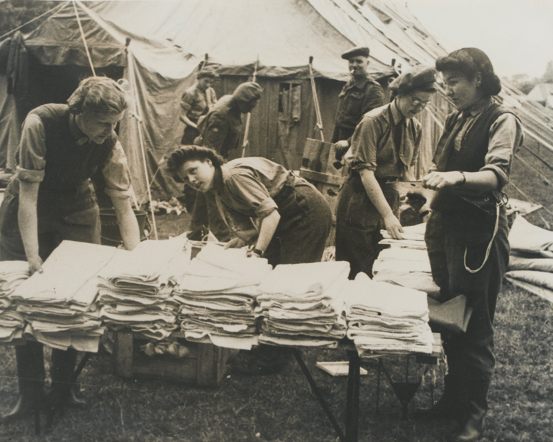 Women of QAIMNS unpacking stores on arrival in Normandy, July 1944