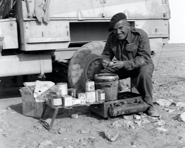 Sub-Conductor Mayland, Army Service Corps, preparing rations in the desert, 1942