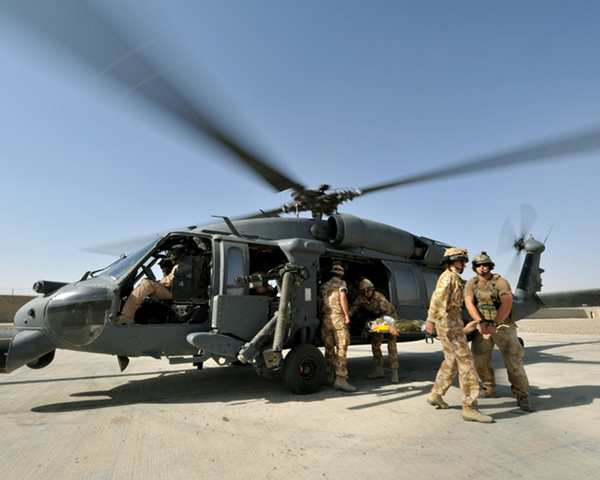 A casualty arrives at Lashkar Gah medical centre by Black Hawk helicopter, 2009