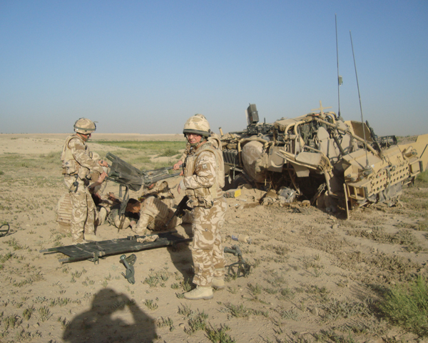 Treating wounded soldiers after an IED damaged their vehicle, 2007