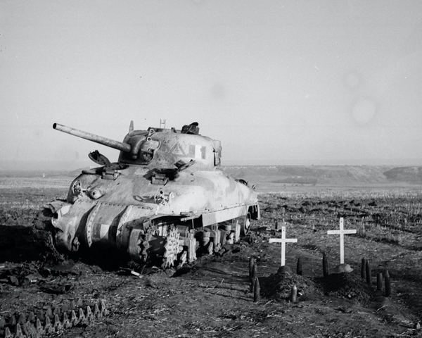 Sherman tank, with graves of crew members, Italy, c1943