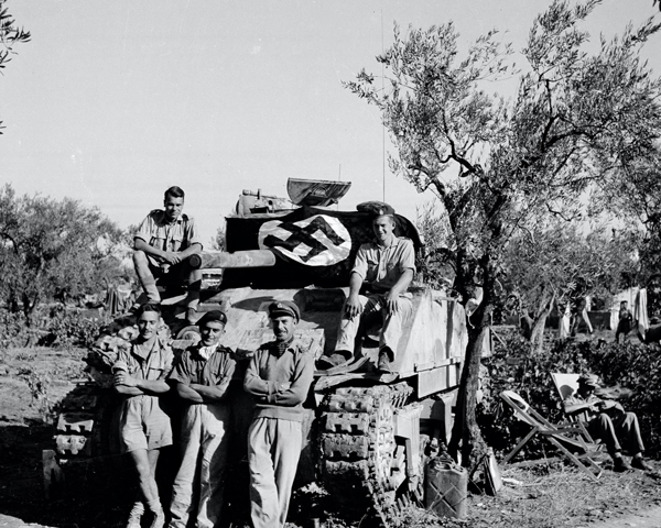 A Sherman tank crew pose with captured flag, 3rd/4th County of London Yeomanry (Sharpshooters), Italy, 1943