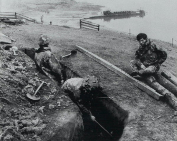 Gurkhas digging a defensive position on the shore of San Carlos Bay, 1982