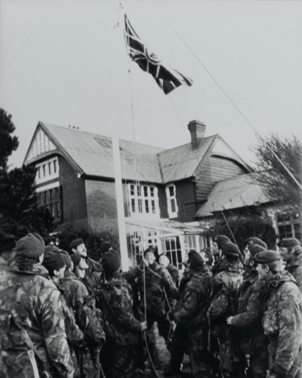 Royal Marine Commandos hoisting the original Union Jack at Government House, Port Stanley, June 1982