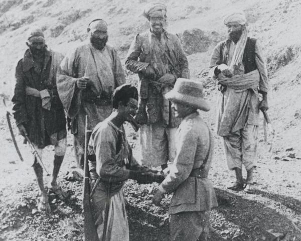 Major M C Holmes conferring with Afridi tribesmen, c1925