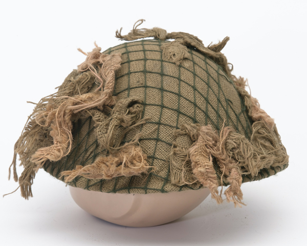 Helmet worn by a Scots Guardsmen in the Falklands, 1982