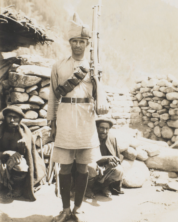 An Afridi of the Frontier Constabulary with Kohistani prisoners, 1934