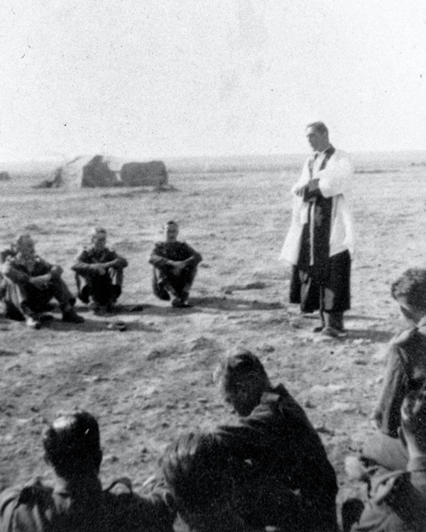 The Rt Reverend Hugh Rowlands Gough, Chaplain to 1st Battalion, The London Rifle Brigade, ministering to the soldiers in the desert, 1942