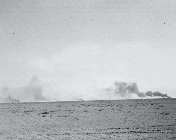 Burning armoured vehicles in the Western Desert, 1942