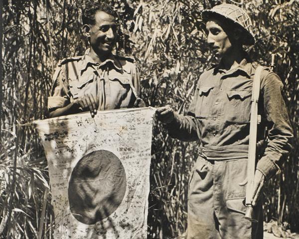 Punjab Regiment troops with a captured Japanese flag, Arakan, c1945