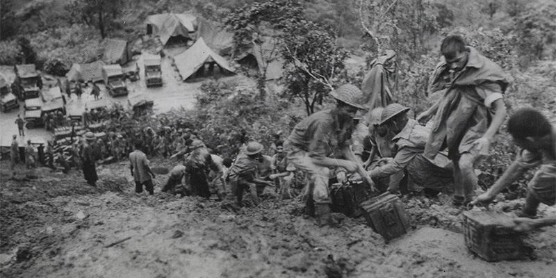 Indian troops moving ammunition down a slope, Burma, c1944