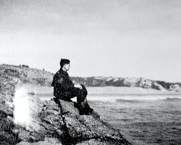 A member of the 3rd County of London Yeomanry (Sharpshooters) enjoys the relative tranquillity of the Pembrokeshire coast, February 1941