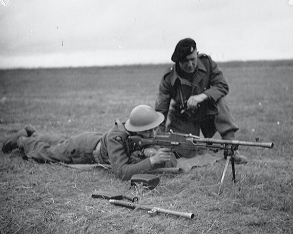 'Clicker Smith' of the 3rd County of London Yeomanry using a Bren gun, Westbury, 1941