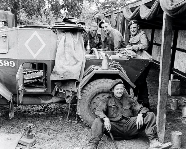 'At work on a scout car', 3rd County of London Yeomanry (Sharpshooters), Westbury, 1941