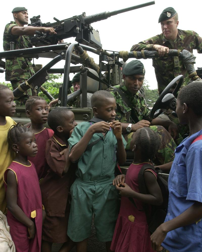 British soldiers with civilians in Sierra Leone, 2001