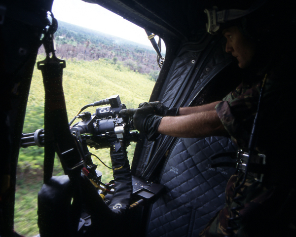 A CH47 Chinnock Minigunner in action during Operation Barras, 2000