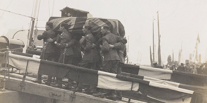 The coffin of the 'Unknown Warrior' being carried on to the Royal Navy destroyer HMS 'Verdun', Boulogne, 10 November 1920