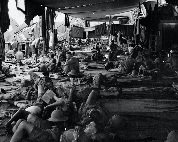 Airing blankets on the troop deck of HMT 'Orion', 1941