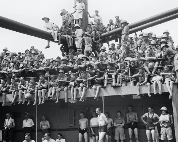 Troops watching a 'Crossing the Line' ceremony on HMT 'Orion', 1941