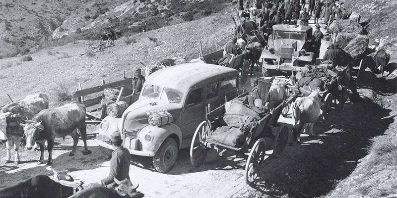 British vehicles pass through a Greek column, 1941