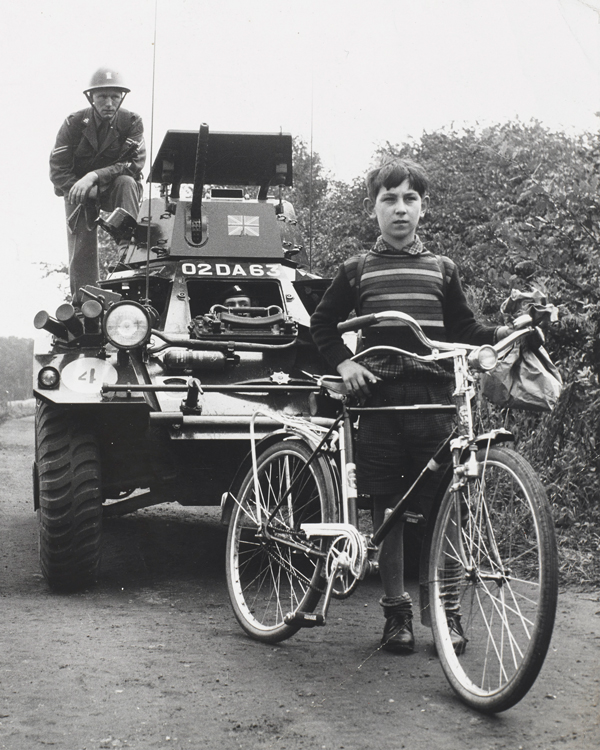 A British Army Ferret scout car and a schoolboy in West Berlin, 1961