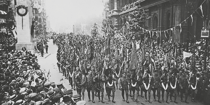 Soldiers march past newly erected Cenotaph on Peace Day, 19 July 1919