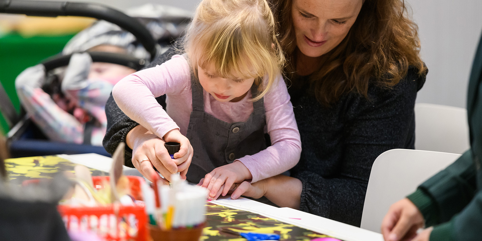 Mother and daughter involved in a craft workshop