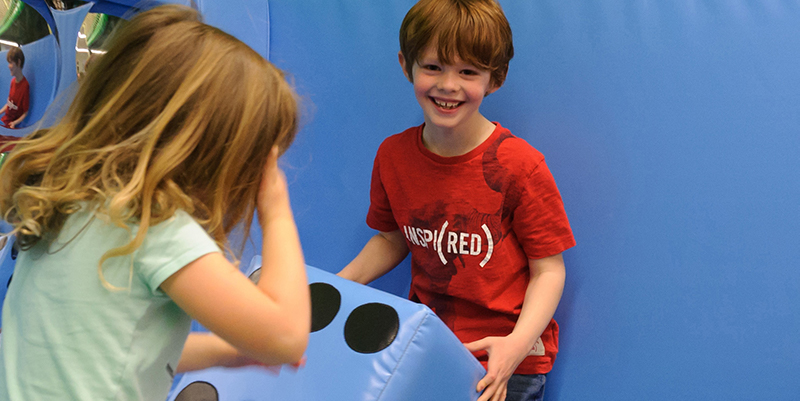 Children attending a giant games workshop